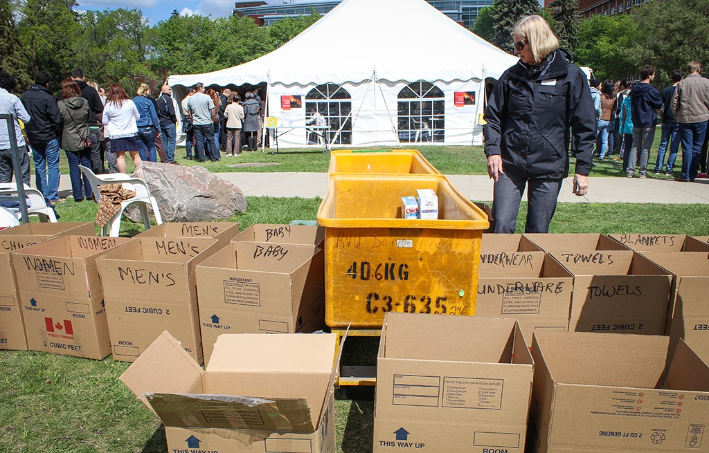 A volunteer takes stock of donations at a May 10 barbecue in support of Fort McMurray. (Photo- Hallie Brodie)