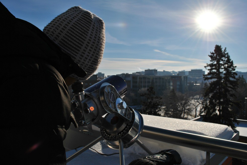 A young visitor peers at the sun through a special telescope at the U of A Observatory.