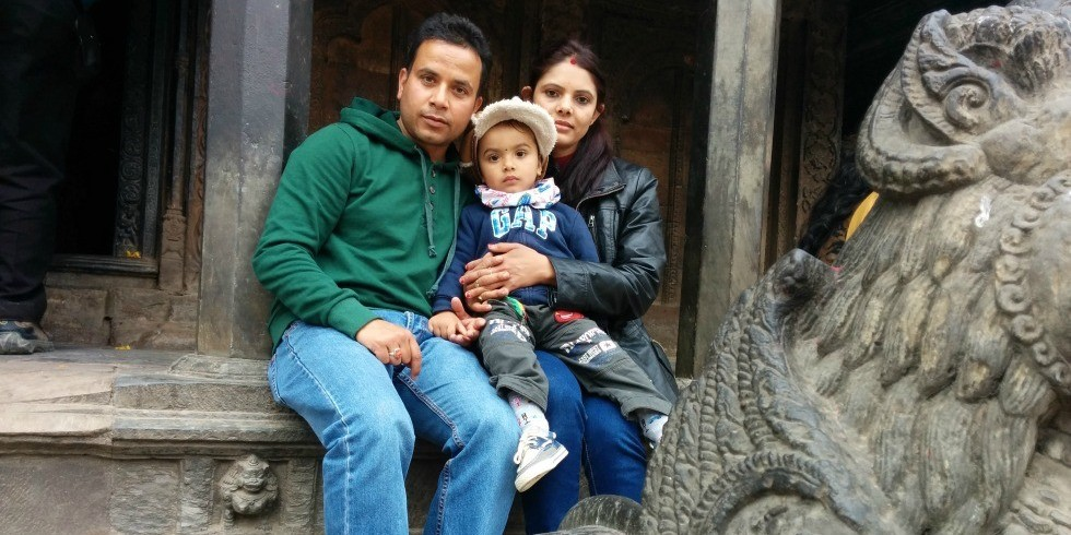 Baiku Acharya with his family at a historic monument in Patan Durbar Square in Kathmandu Valley in February 2015. The site was destroyed by the earthquake that struck Nepal April 25.