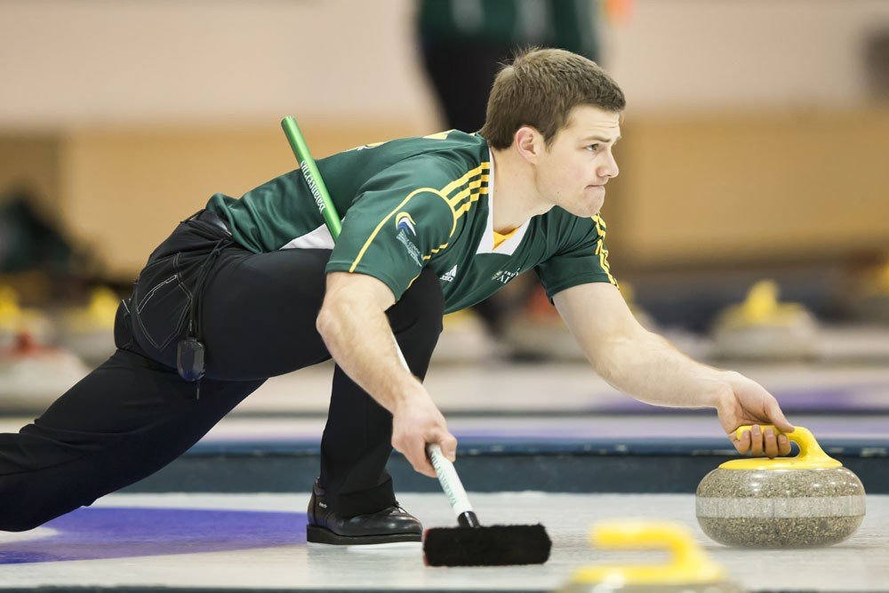 Golden Bears second Brad Thiessen throws a rock. The Bears curling team won their second consecutive western regional championship banner in the 2013-14 season. Both the Bears and Pandas rinks finished with silver medals at the CIS national championships.