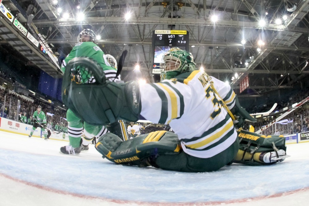 Kurtis Mucha makes one of his 20 saves against the University of Saskatchewan Huskies in helping his Golden Bears hockey team win the program's record 14th national championship. Mucha's exceptional year also saw him suit up for a practice Dec. 11 with the Boston Bruins and fill in as backup goalie for the Edmonton Oilers March 4.