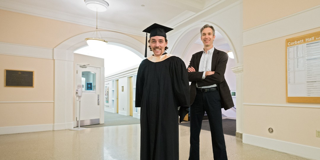 Callum Lavoie with his graduate supervisor, physical therapy professor Doug Gross, in Corbett Hall. Lavoie achieved his dream of going to medical school after finishing his master's thesis in less than a year. (Photo: Richard Siemens)
