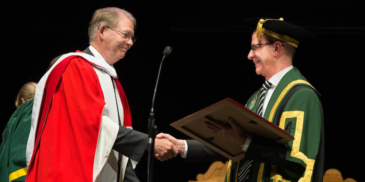 Chancellor emeritus Ralph Young receives his honorary doctor of laws degree from current chancellor Douglas Stollery during convocation ceremonies on November 15. (Photo: Richard Siemens)