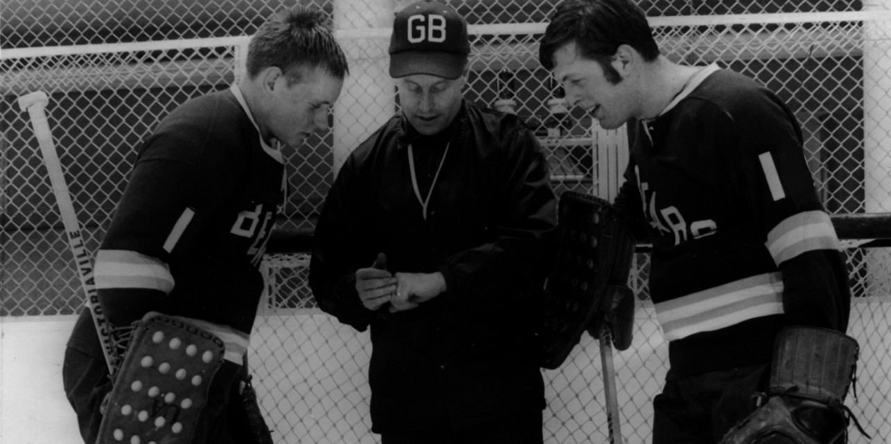 Clare Drake, seen here speaking with Golden Bears goalies Barry Richardson (left) and Jim Coombs during the 1971-72 campaign, will be inducted into the Hockey Hall of Fame in November.