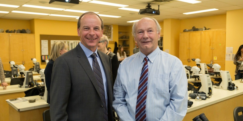 Ken Lueers, '85 BSc (left), president of ConocoPhillips Canada, reunites with his former professor, Brian Jones of the Department of Earth and Atmospheric Sciences, during a Nov. 21 visit to the campus lab named in recognition of the company's ongoing support of the faculties of science and engineering. (Photo: Ryan Whitefield)