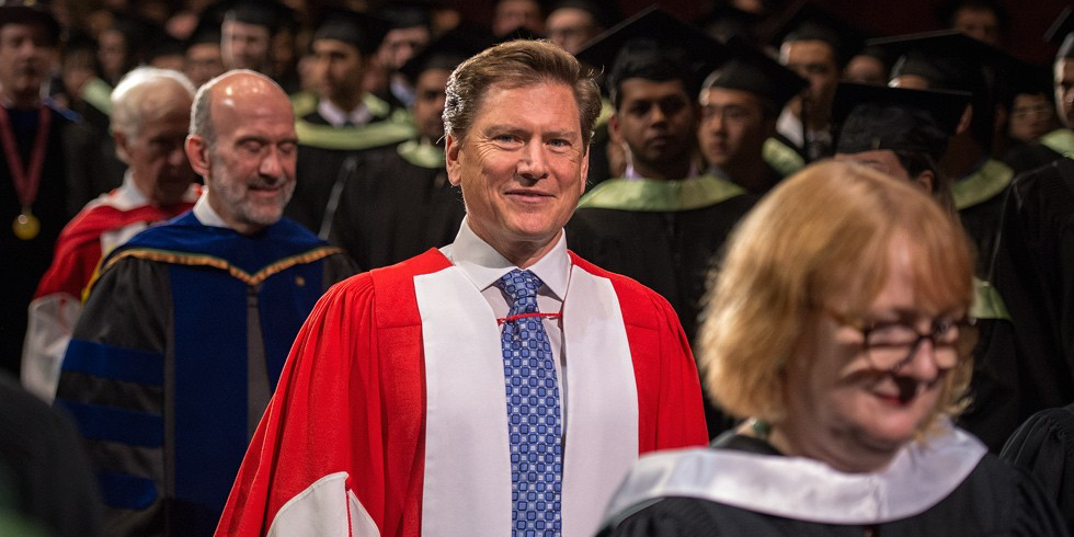 Darren Entwistle proceeds to the stage to receive his honorary doctor of laws degree June 5. (Photo: Richard Siemens)
