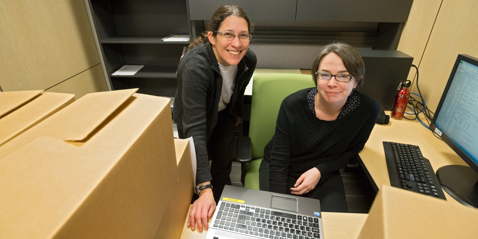 Data detectives: Post-doctoral fellow Kendall Roark (right) and metadata librarian Sharon Farnel with boxes containing some of the 135 cubic feet of paper data that will be catalogued for health researchers to discover. (Photo: Richard Siemens)
