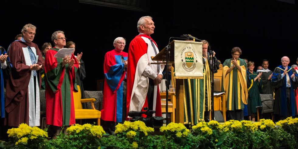 David Schindler is applauded after receiving his honorary doctor of science degree June 10. (Photo: Richard Siemens)