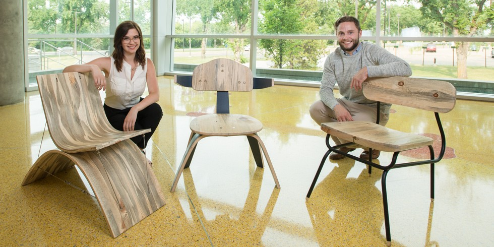 Design students Jillian Richards and Maxwell Hurd show off three of the chairs they created using beetle-killed pine.
