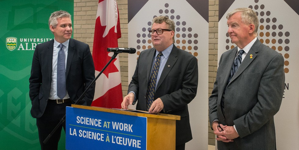 Ed Holder, minister of state for science and technology (middle), is joined by Edmonton MPs Mike Lake (left) and Laurie Hawn (right) at the Jan. 19 announcement of $342M in federal funding to support indirect costs of research. (Photo: Richard Siemens)