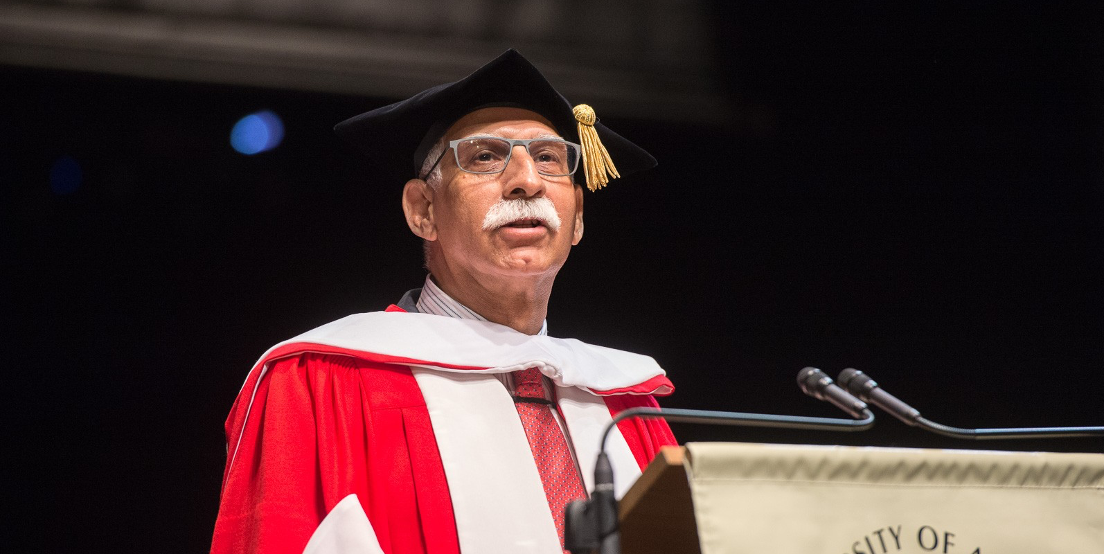 Firoz Rasul, president of Aga Khan University, addresses graduates after receiving an honorary Doctor of Science degree on June 8. (Photo by Richard Siemens)