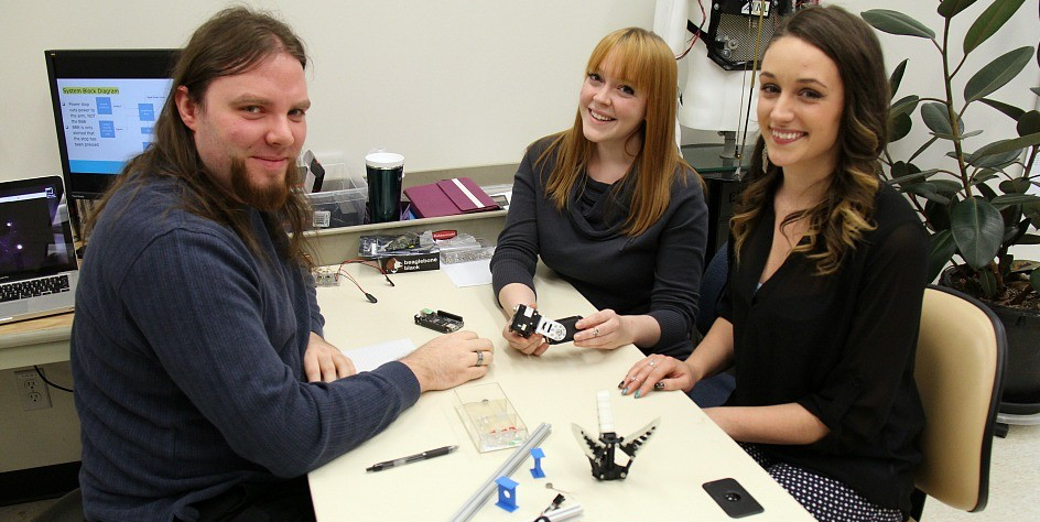 (From left) Electrical engineering students Adam Parker, Sarah Lezarre and Laura Bennet are designing and building a robotic prosthetic arm for their capstone project.