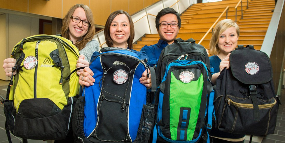 (From left) Kelsey McDougall, Katelyn Lee, Kevin Chung and Elizabeth Morris raised enough donated items to fill 33 backpacks. (Photo: Richard Siemens)