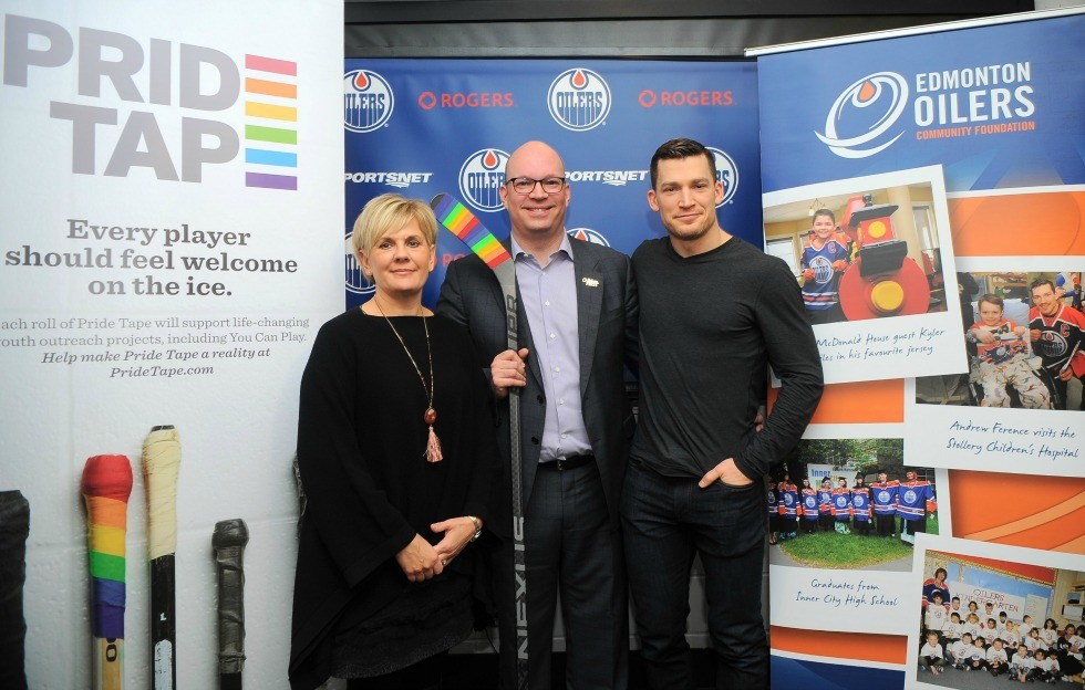 (From left) Natalie Minckler, executive director of the Edmonton Oilers Community Foundation, with Kris Wells and Andrew Ference