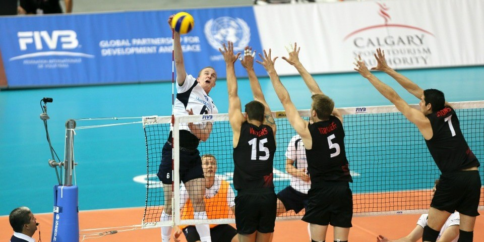 Golden Bears alumnus Dallas Soonias (right) and his teammates leap to block a shot during Team Canada's World League win over Finland May 31. (Photo courtesy FIVB)