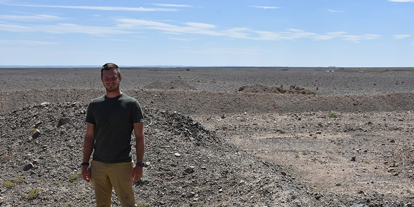 Gregory Funston, PhD student, near the Avimimus bonebed site in Mongolia. Photo cred: Phil Bell.