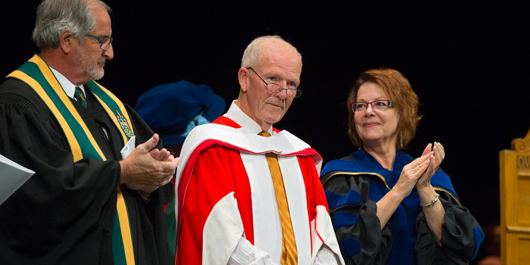 Dennis Erker receives a warm reception from the convocation audience after receiving his honorary doctor of laws degree from the University of Alberta Nov. 19. (Photo: Richard Siemens)