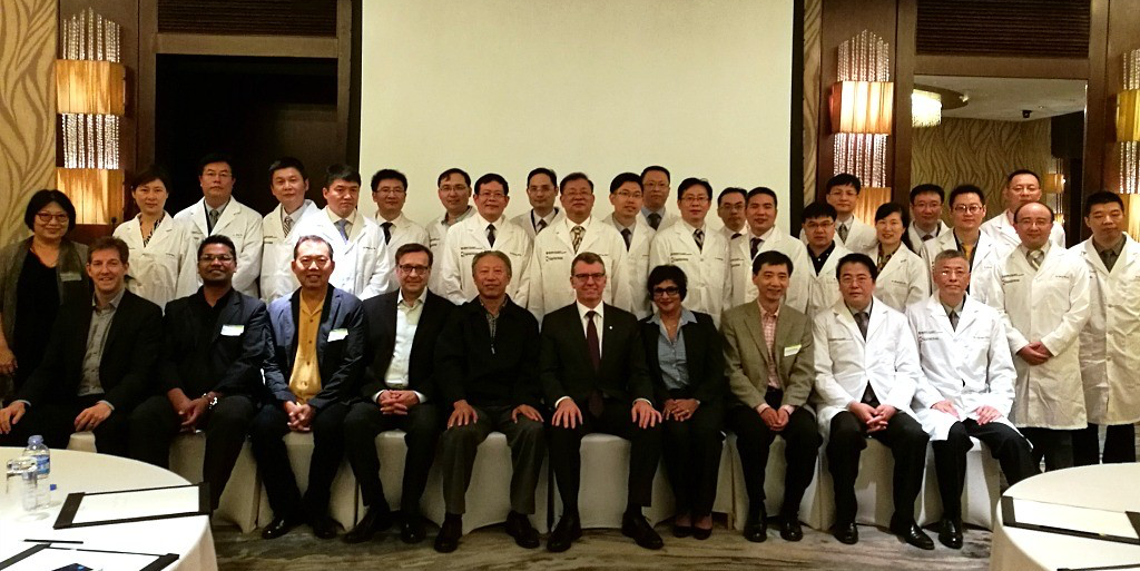 International impact: Shao-hua Wang (seated third right) was honoured Oct. 15 in Shanghai for his 20 years spent mentoring dozens of heart surgeons from his native China.