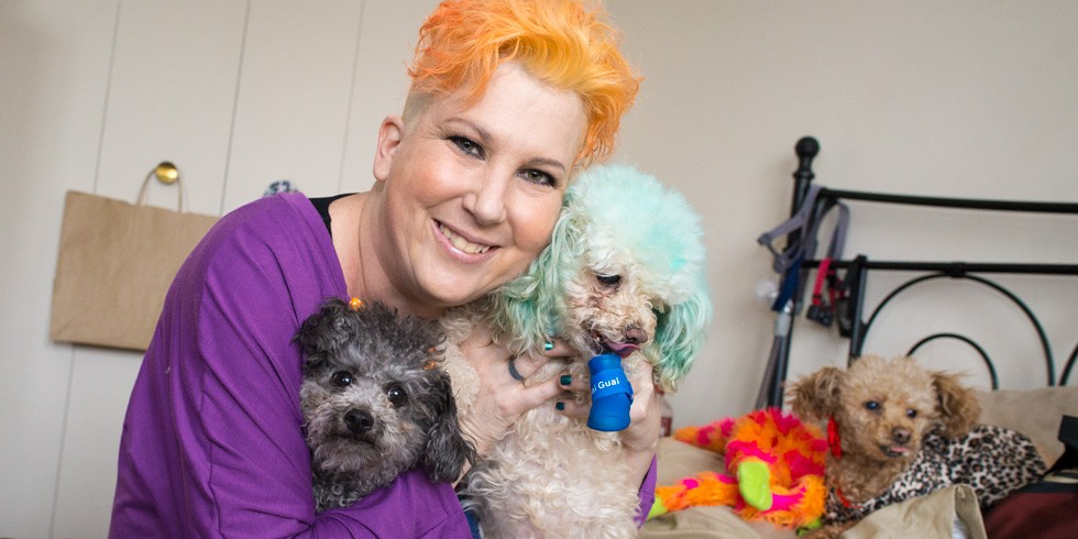 Jill with her adoptive family, a trio of toy poodles that have sustained her through tough times (Photo: Richard Siemens)