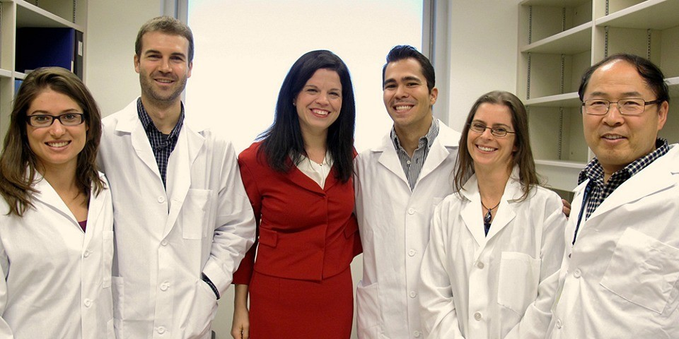 Lynne Postovit (centre) with members of her research team.