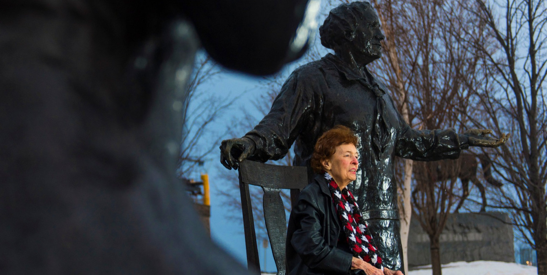 Dr. Marguerite Ritchie (University of Alberta alumna, retired Department of Justice lawyer, human rights activist and philanthropist) at the Supreme Court of Canada and with the Famous Five statues. In Ottawa, Ontario on March 24, 2015. ©2015 John Ulan