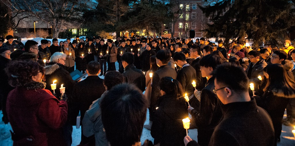 Mourners gather at the candlelight vigil held Feb. 18 to honour the lives of three U of A students from China who were killed in a tragic vehicle accident. (Photo: Richard Siemens)
