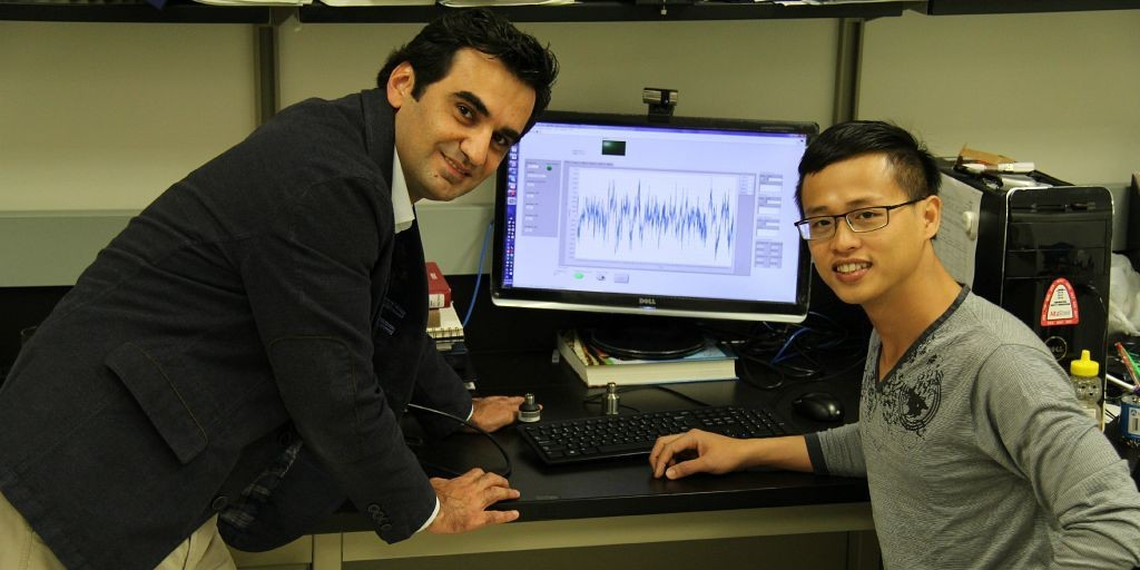 Mustafa Gül (left) inspects sensors with graduate student Ngoan Do. Gül is leading a new research program to monitor the structural health of Canada's railway infrastructure.
