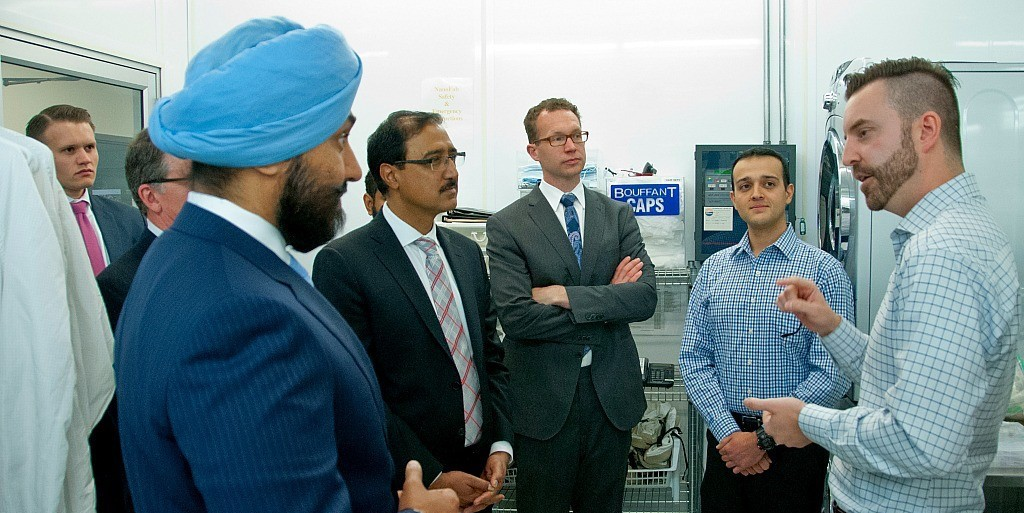 (From left) Navdeep Bains, minister of innovation, science, and economic development; Amarjeet Sohi, minister of infrastructure and communities; and Marlin Schmidt, Alberta minister of advanced education, tour the nanoFAB facility in the Electrical and Computer Engineering Research Centre.