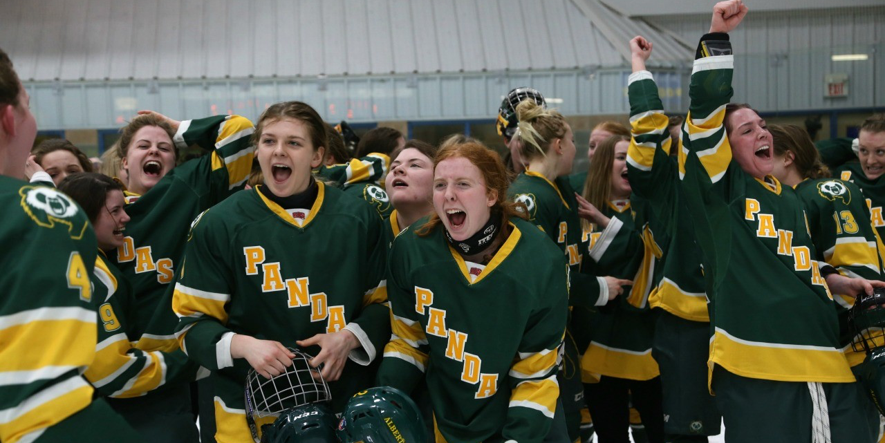 Pandas hockey players celebrate their dramatic double overtime win against McGill to seal the UAlberta program's eighth national championship March 19.
