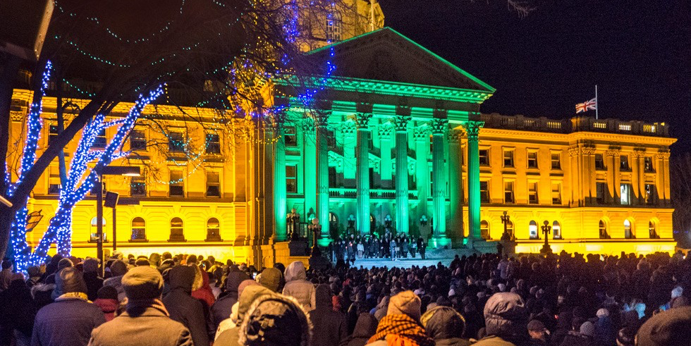 People gather at the Alberta Legislature to hold a candlelight vigil for victims of the Jan. 30 terror attack at a Quebec City mosque. (Photo: Richard Siemens)