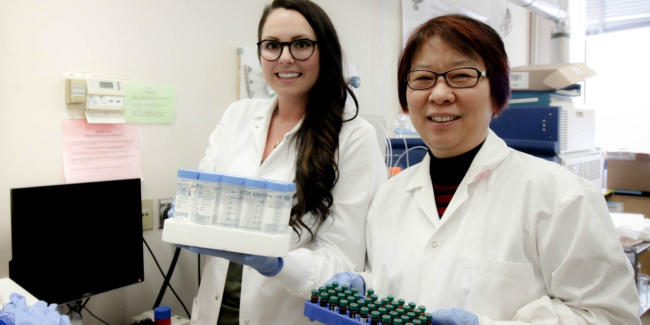 PhD student Lindsay Blackstock (left) and her supervisor, Xing-Fang Li, found telltale signs of urine in public swimming pools by looking for traces of artificial sweetener.