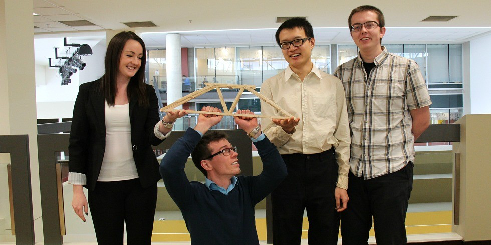 (From left) Civil engineering students Randi Buchner, Brett Morgan, Tony Dong and Jeremy Maetche are raising funds to get to the national Popsicle stick bridge building competition. They say they could build a bridge capable of holding the weight of three pickup trucks.