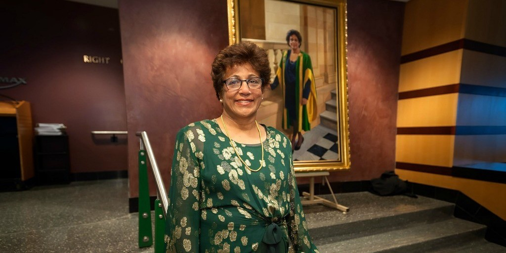 President Indira Samarasekera with the portrait she received during a gala evening last April honouring her contributions to the University of Alberta community, the city of Edmonton and the province.