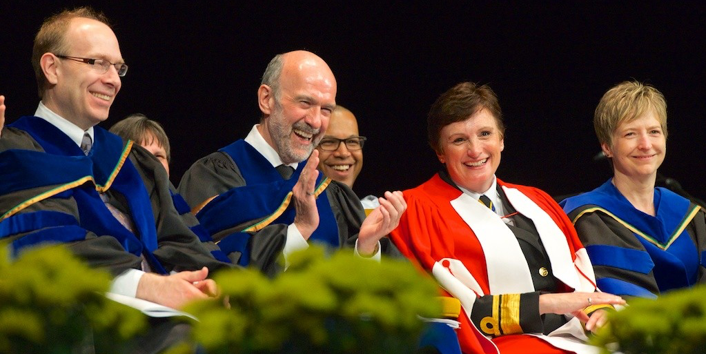 Rear-Admiral Jennifer Bennett and Dean David Lynch of the Faculty of Engineering enjoy a moment of mirth during convocation ceremonies June 9. (Photo: Richard Siemens)
