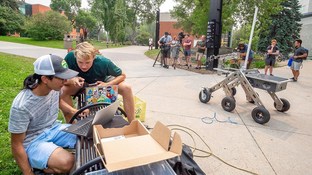 A group of U of A students demonstrate TARS, a rover they designed and built that will be competing at Canada's premier international space robotics competition this weekend. (Photo: Richard Siemens)