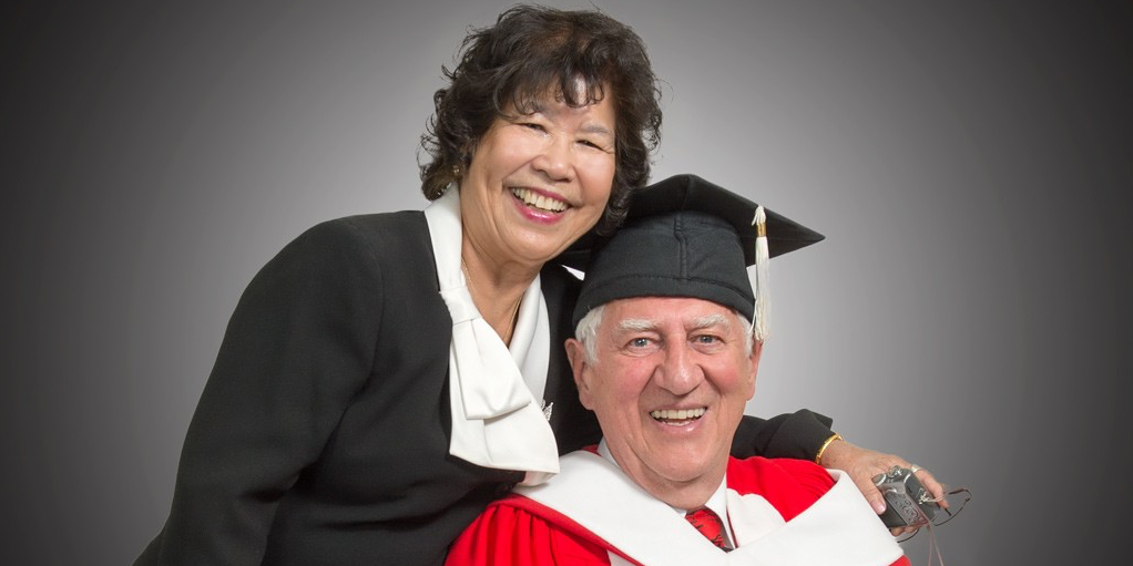 Russell Schnell with his wife, Suan Tan Schnell, before receiving his honorary doctor of science degree from the U of A at the Augustana Campus convocation ceremony May 31. (Photo: Richard Siemens)