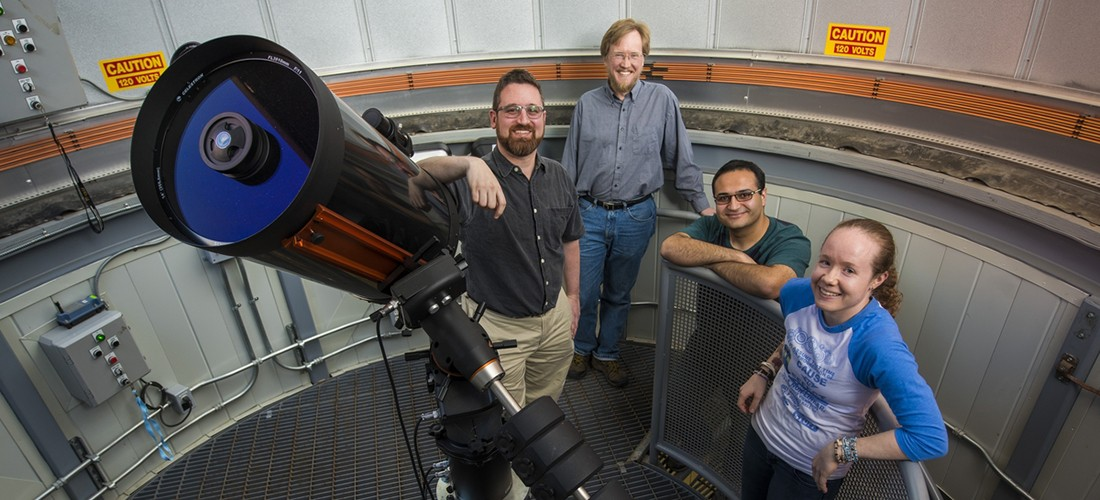 UAlberta physicists (right to left) Bailey Tetarenko, Arash Bahramian, Craig Heinke, Gregory Sivakoff, and Robin Arnason (not pictured) led an international group of collaborators in the discovery of a black hole that suggests there may be vast numbers of black holes in our galaxy that have gone unnoticed until now.