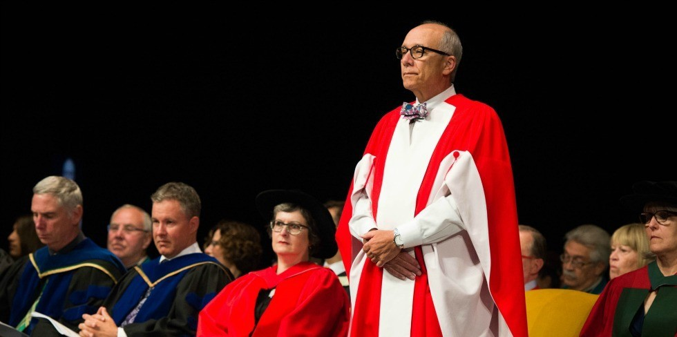 Stephen Mandel stands for his introduction before receiving his honorary doctor of laws degree during convocation ceremonies June 15. (Photo: Richard Siemens)