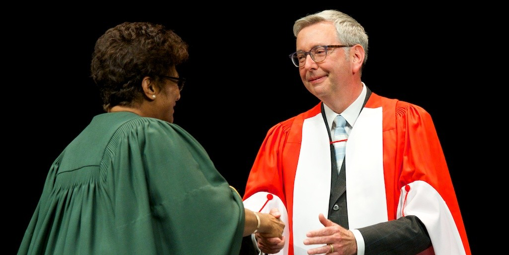 Stephen Toope is welcomed to the convocation stage by President Indira Samarasekera before receiving his honorary doctor of laws degree June 8. (Photo: Richard Siemens)