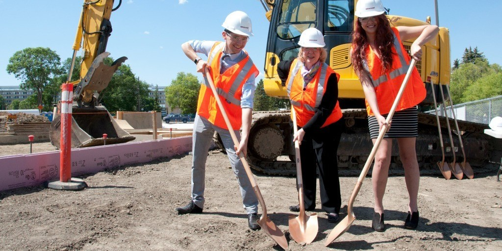 Students Justin Draper and Miranda Dela Cruz join Kim Campbell, founding principal of the Peter Lougheed Leadership College, at the groundbreaking ceremony for the college's future home, Peter Lougheed Hall, set to open in 2017.