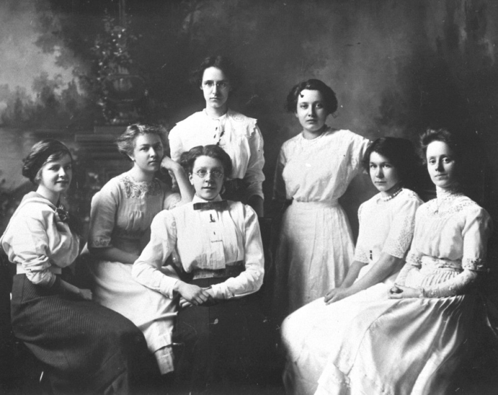 The 1911 Wauneita Society (from left)- Sylvia Robertson, Libby Lloyd, Decima Robinson, Helen Montgomery, Kathleen Lavell, Agnes Wilson, Mary Millar. (Photo courtesy U of A Archives, UAA 69-132-2)