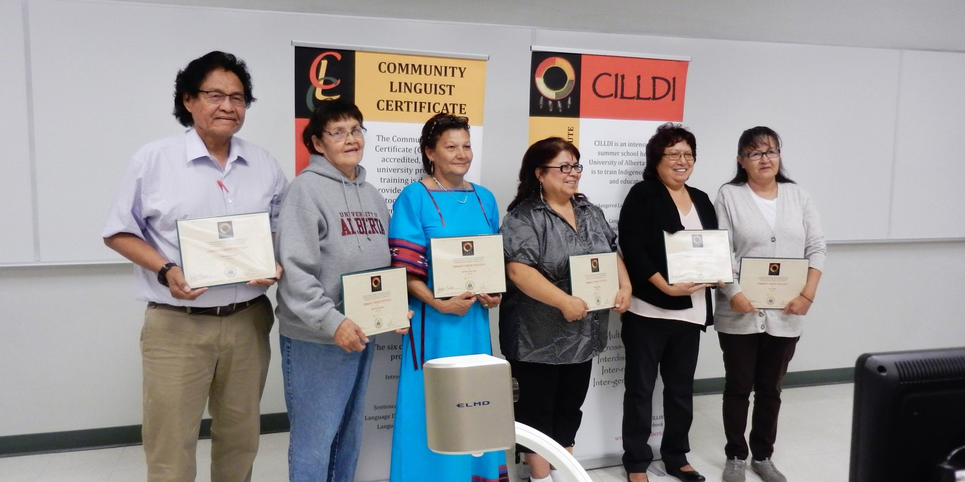 The latest group of students in CILLDI's Summer Program show off their community linguist certificates.