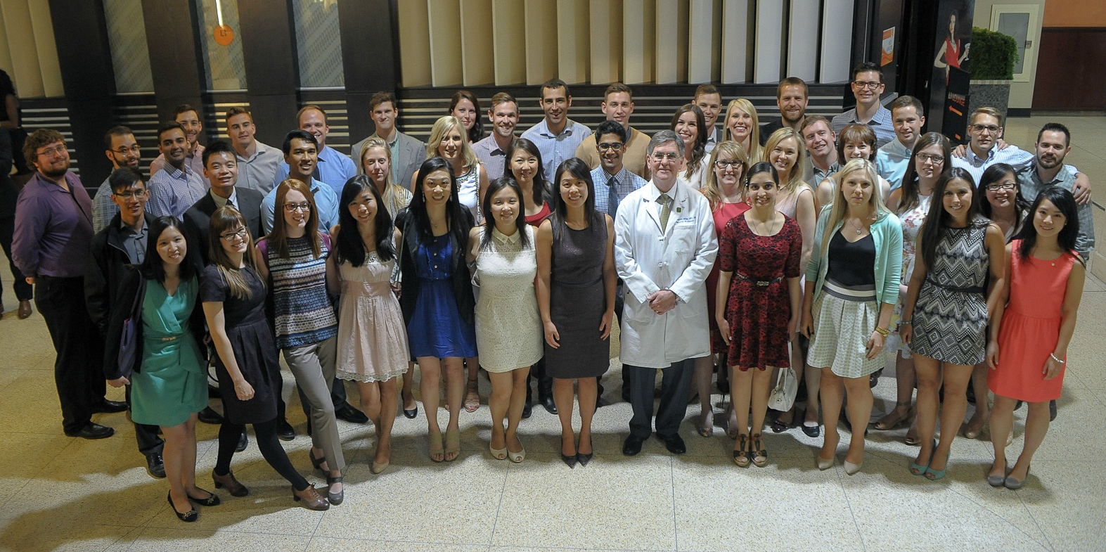 The medical graduates of 2014 who are choosing careers as family doctors, with dean of medicine and dentistry D. Douglas Miller.