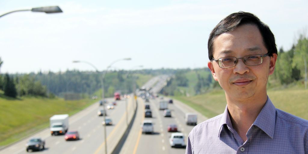 Civil engineering professor Tony Qiu, director of the Centre for Smart Transportation, watches traffic on the Whitemud Freeway. Qiu's research team is working with the City of Edmonton to solve traffic congestion and safety issues on the freeway.