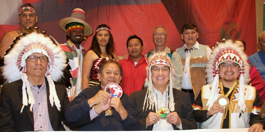 Treaty 6 Grand Chief Wilton Littlechild (seated, second right) was among Indigenous representatives from around the world who signed a declaration of intent to bring the 2017 World Indigenous Nations Games to Edmonton next July.