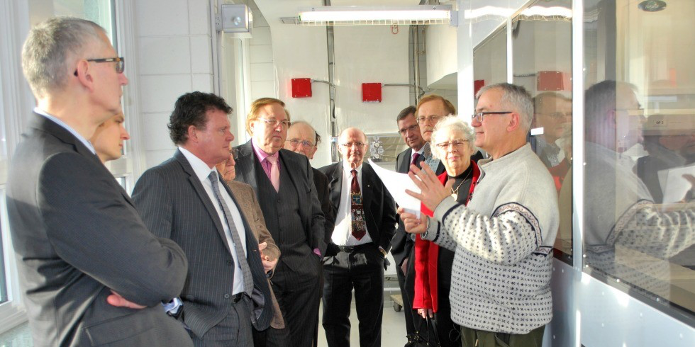 William Shoytk (right), Bocock Chair in Agriculture and the Environment at UAlberta, gives a tour of the $4.7-million ultra-clean lab during its official opening.