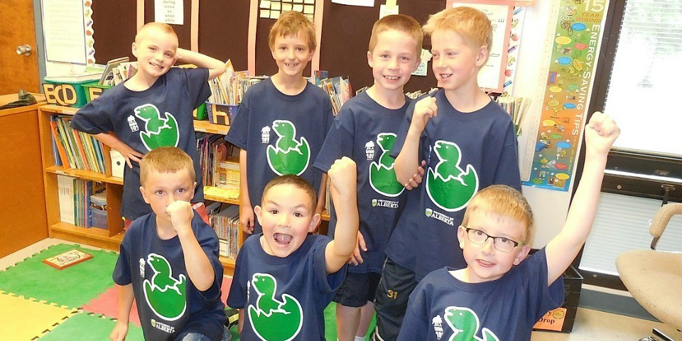 Young paleontology buffs from Bertha Kennedy Catholic Community School sport their Dino 101 T-shirts. (Photo: Dolores Andressen)