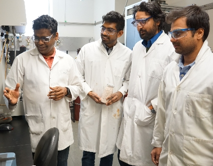 Engineering professor Arvind Rajendran (left) in his lab with graduate students Vishal Subramanian Balashankar, Kasturi Nagesh Pai and Gokul Subraveti. The research team developed a two-step screening process to assess a potentially more efficient carbon-capturing solid in seconds, rather than the day it would take using traditional methods. (Photo: Catherine Tays)