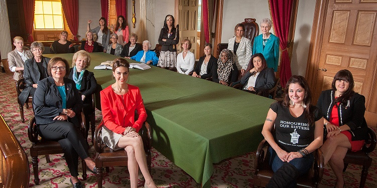 Seated around the Confederation Table at Province House in PEI in a recreation of the famous Robert Harris painting of the Fathers of Confederation are 2014 Bold Visionaries (clockwise from top right): Kluane Adamek, Crystal Fraser, Nazanin Afshin-Jam MacKay, Lana Payne, Kim Campbell, Shelagh Day, Becka Viau, Bonnie Brayton, Carolyn Bennett, Jessie Housty (standing), El Jones (standing), Maria Mourani, Eva Aariak, R. Irene d'Entremont, Hazel McCallion, Pamela Palmater, Catherine Potvin, Natalie Panek, Eman Bare, Mina Mawani (standing) and Margaret-Ann Armour (standing). Missing from photo: Libby Burnham. (Photo: Brian Simpson)