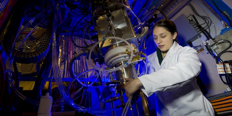 Dr. Katie Gagnon works on the new cyclotron at the Medical Isotope and Cyclotron Facility, which manufactures isotopes needed for diagnostic imaging.